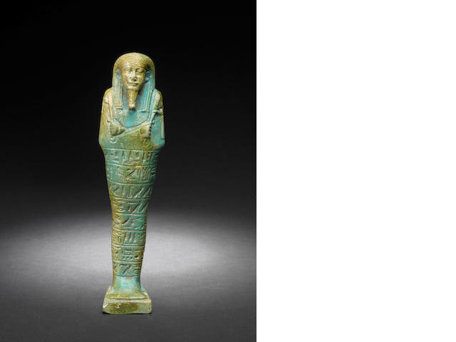 A Egyptian green glazed composition shabti