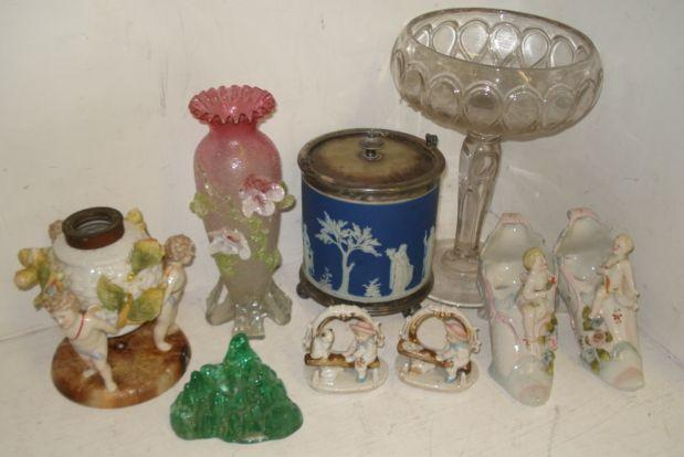 A Sitzendorf oil lamp base, supported by three cherubs, electroplate mounted Wedgwood blue jasper dip biscuit barrel, pair of novelty posy holders, in the form of shoes, other decorative ceramics, a Victorian glass comport, a Webb's satin glass baluster vase and other 19th Century coloured glasswares.