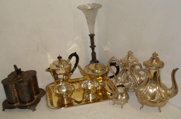 A Victorian electroplate biscuit box, Mappin & Webb, of quatre lobed outline, the hinged cover with a lion supporting a shield finial, Victorian style foliate embossed tea and coffee service, four piece tea service and tray, a Samovar and various other electroplate.