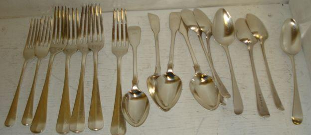 Five Hanoverian pattern silver table forks, Barker Brothers & Son Ltd, Birmingham 1930, and two similar dessert forks, Charles Boyton & Sons, Sheffield 1930, six George III Old English pattern dessert forks, various dates and makers, three Victorian fiddle pattern dessert spoons, Mary Chawner 1838 and a William IV similar. (17)