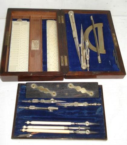 A set of 19th Century drawing instruments, including three ivory rules, signed 'J Cail Newcastle On Tyne' ebony and brass parallel rule, brass protractor, lift-out tray with polished steel and ivory instruments, all contained in a rosewood box.