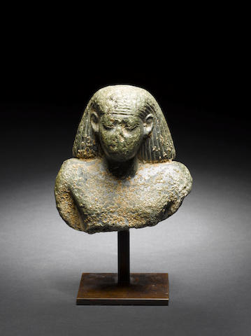 An Egyptian green stone bust of an official