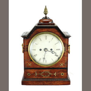 A Regency brass inlaid rosewood mantel clock