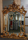 A large gilt composition overmantel mirror in the Rococo style