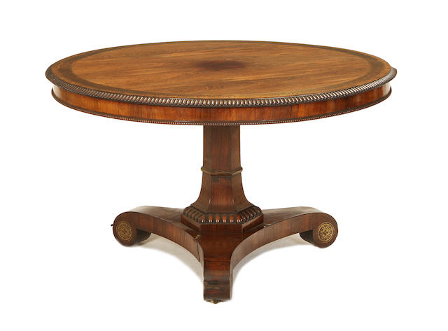 A William IV rosewood and brass inlaid breakfast table