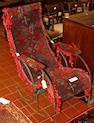 A late 19th Century steel rocking chair,