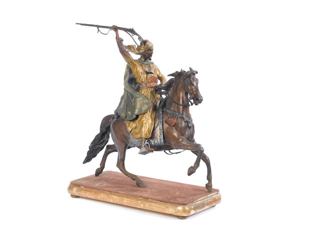 Franz Bergman (Austrian, fl. late 19th / early 20th century) A cold painted bronze model of an Arab warrior seated on horseback