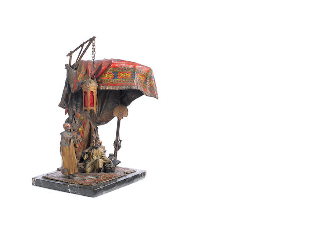 A cold painted bronze orientalist lamp depicting the tent of a bead merchant