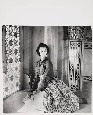 Norman Parkinson (British, 1913-1990) Winter Sunshine Wardrobe in India, Ann Gunning wearing Harvey Nichols moygashell linen skirt and Shantung blue shirt, for Vogue, 1956 Paper 38.1 x 30.6cm (15 x 12 1/16in), image 28.8 x 29.1cm (11 5/16 x 11 7/16in)