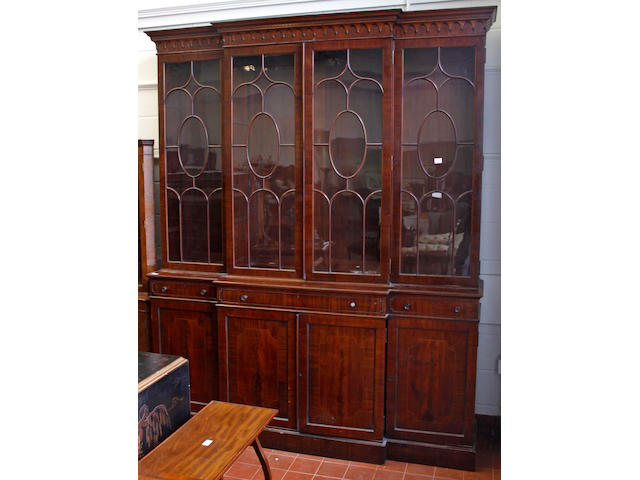 A mahogany breakfront bookcase, 20th century