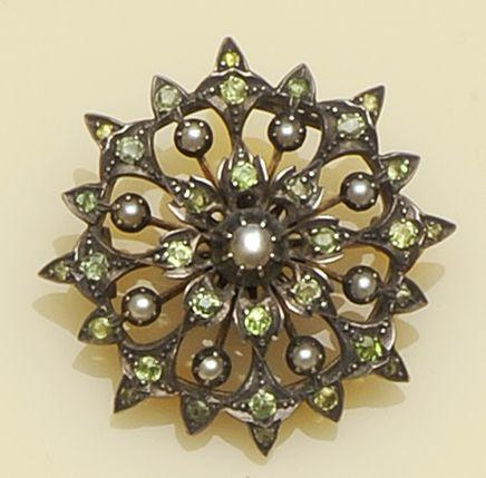 A 19th century peridot and half pearl brooch
