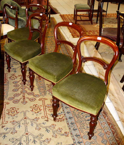 A set of four Victorian mahogany open back dining chairs