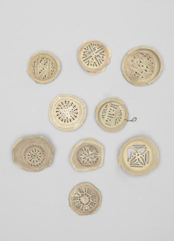 A group of nine Fatimid unglazed pottery Water Filters Egypt, 10th/ 11th Century(9)