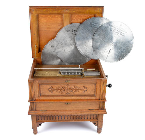 Stella 17.1/2-inch disc musical box on original stand, with quantity of discs