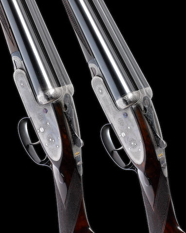 A pair of 12-bore self-opening sidelock ejector guns by J. Purdey & Sons, no. 21818/9 In their brass-mounted oak and leather case, and together with two Parsons canvas slips