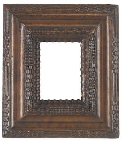 A Dutch 17th Century carved walnut ripple moulding frame,