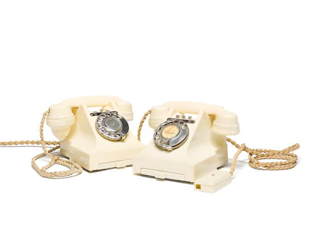 Two 314L type ivory bakelite telephones: impressed marks: 164 54 and 164 56,