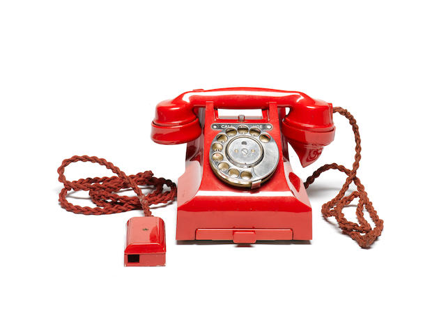A near-mint type 312L red bakelite telephone, impressed mark 164 57,