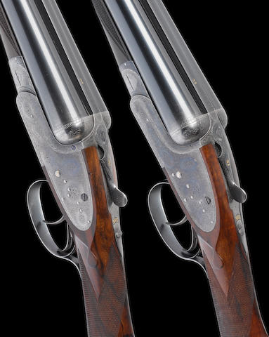 A matched pair of 12-bore sidelock ejector guns by Boss & Co., no. 4874/5575 In their brass-mounted oak and leather case