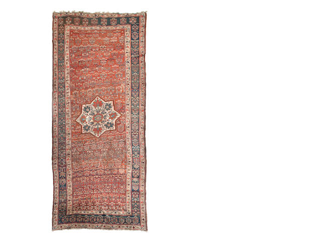 A North West Persian rug 337cm x 173cm.