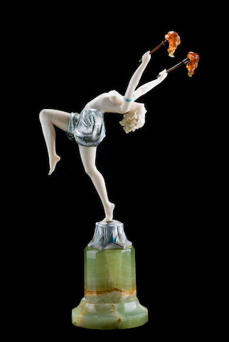 Ferdinand Preiss (1882-1943) 'Torch Dancer', circa 1925 A cold-painted bronze and ivory figure modelled balancing on one leg, her back arched, holding up two torches, wearing only a pair of culottes, on a green onyx base, signed F. Preiss