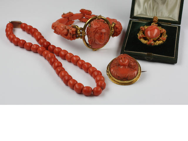 A Victorian carved coral articulated bangle (4)
