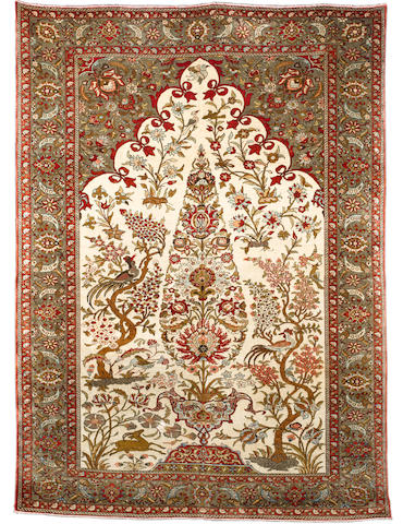 A Ghom silk rug, Central Persia, circa 1950, 210cm x 153cm (6ft 11in x 5ft) excellent condition