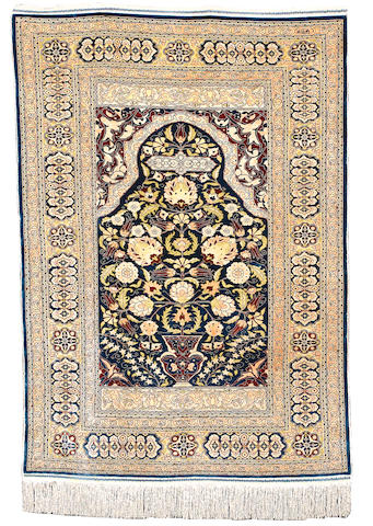 A Hereke silk rug, West Anatolia, circa 1960, 142cm x 102cm (4ft 8in x 3ft 4in) excellent condition