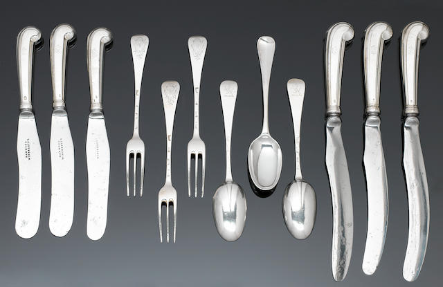 A George I silver Hanoverian pattern table service of flatware, London 1712 - 1724,