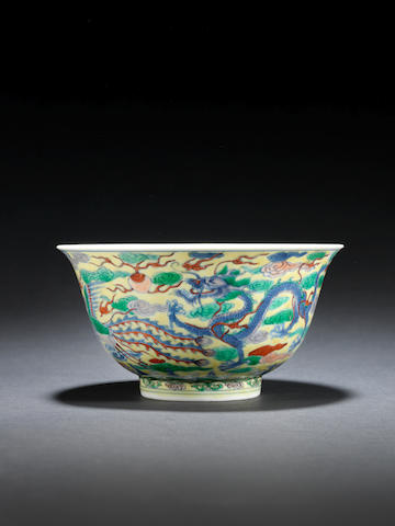 A fine and rare woucai yellow-ground 'dragon and phoenix' bowl Kangxi six-character mark and of the period