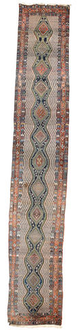 A Kurdish runner, West Persia, circa 1910, 20 ft 1 in x 3 ft 8 in (642 x 111 cm) good condition throughout
