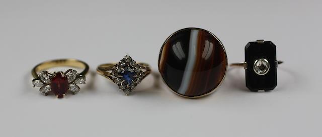 Four gem set rings (4)