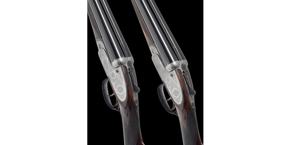 A fine pair of 12-bore (2¾in) self-opening sidelock ejector guns by H. Atkin, no. 2216/7 In their brass-mounted oak and leather case