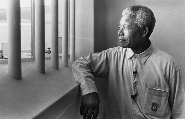 Jürgen Schadeberg (South African/ German, born 1931) Nelson Mandela in his cell on Robben Island (revisit), 1994 Paper 36.6 x 48.8cm (14 3/8 x 19 1/4in), image 29.3 x 45.4cm (11 1/2 x 17 7/8in).
