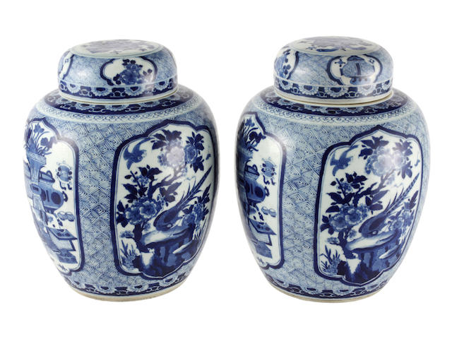 A pair of blue and white baluster jars and covers 19th century