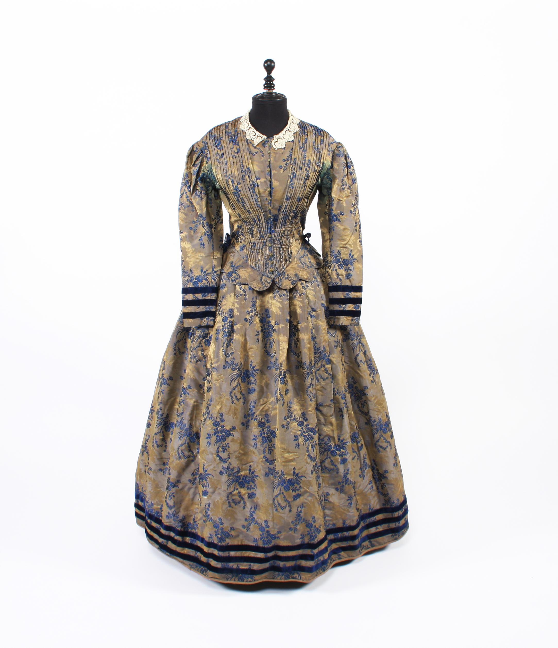 An 1850s shot silk brocade dress