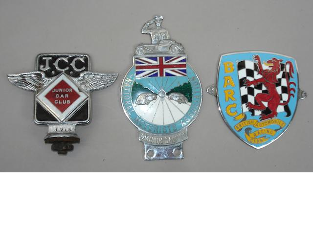 Three motoring badges,