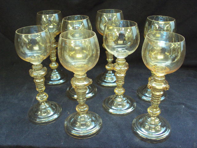 A collection of eight coloured glass goblets
