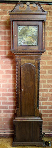 An 18th century composite carved oak longcase clock By Henry Mason