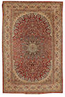 An Isfahan rug, Central Persia,circa 1930, 7f t 1 in x 4 ft 9 in (217 x 145 cm) minor damage to each side, lacking fringes at each end