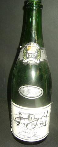 A champagne bottle hand signed by Geoff Boycott