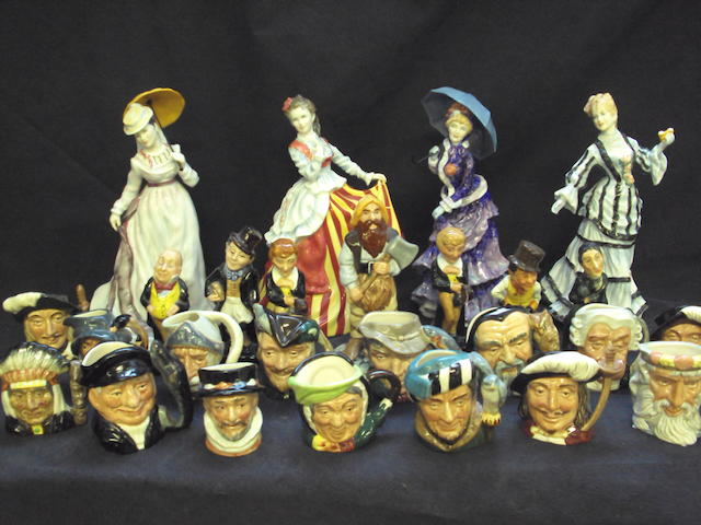 A collection of Royal Doulton figurines and character jugs