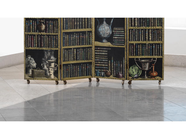 Piero Fornasetti, a four panel 'Libreria' screen, designed and executed circa 1955 lithographic print on wood with brass hinges and castors, the reverse decorated with the 'Canneté' print,