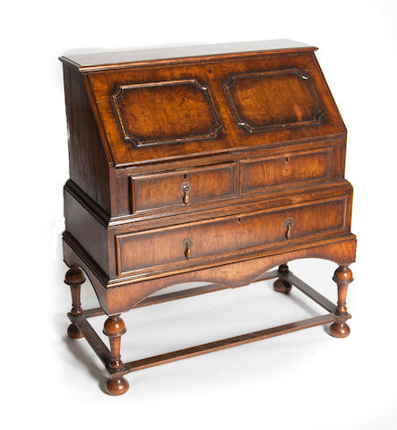 An early 20th century oak bureau in the historical revival style