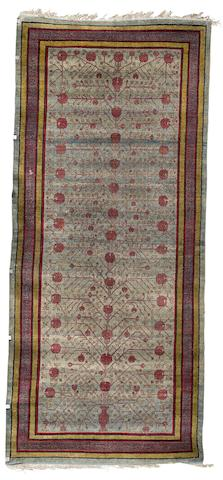A silk Yarkand long rug, East Turkestan, circa 1920, 11 ft 8 x 8 ft 5 in (356 x 257 cm)
