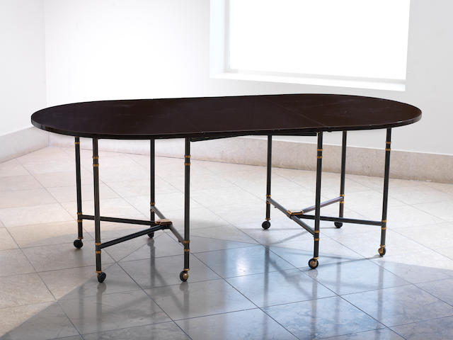 Maison Jansen, a 'Royale' dining table, designed circa 1949 lacquered top with steel and gilt bronze extending and folding frame and additional leaf,