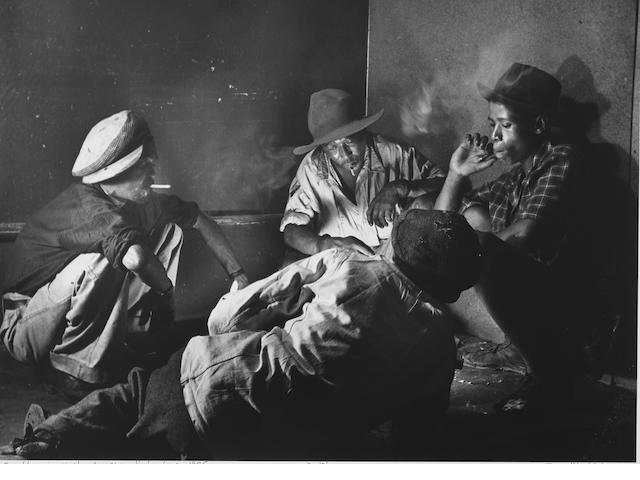 Jürgen Schadeberg (South African/ German, born 1931) Gamblers in a smoky corner in Sophiatown, 1955 Paper 40.3 x 50.2cm (15 7/8 x 19 3/4in), image 33.1 x 45.2cm (13 x 17 3/4in).