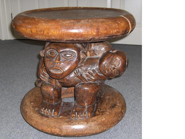 A carved hardwood table with a figural support.