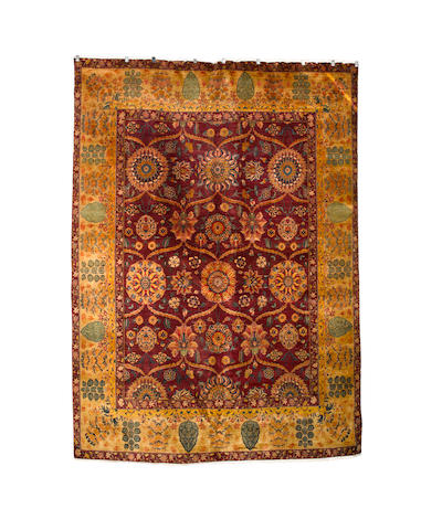An Agra design carpet, 414cm x 303cm