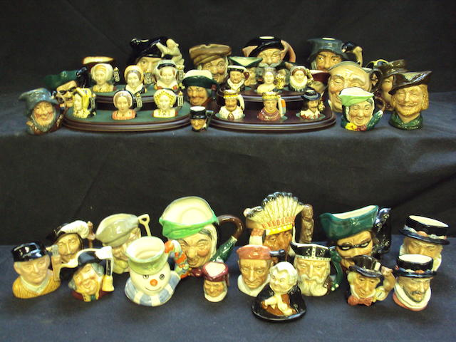 A collection of small and miniature Royal Doulton character jugs